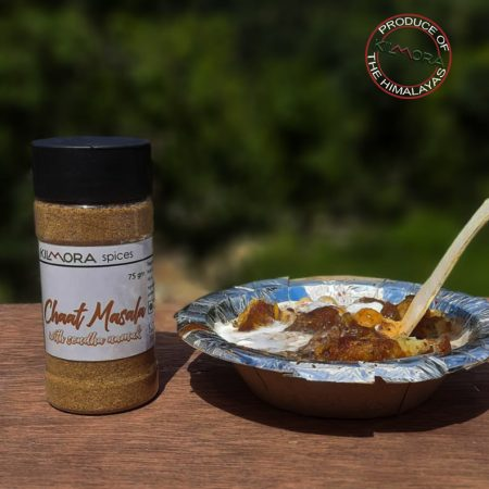 Photograph shows 1 jar with label Chaat Masala with Sendha Namak and a bowl of chaat / savoury next to it