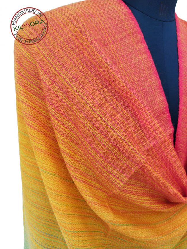 Merino wool shawl in shades of red, green and yellow
