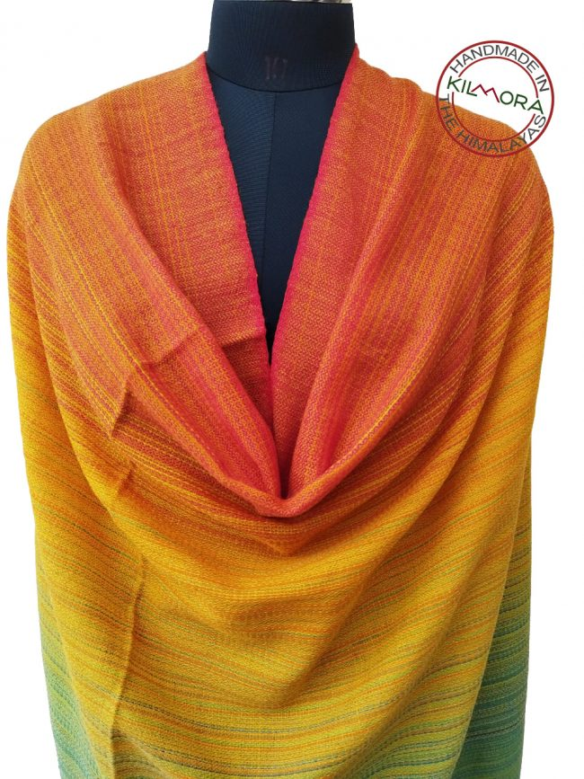 Merino wooal shawl in shades of red, green and yellow